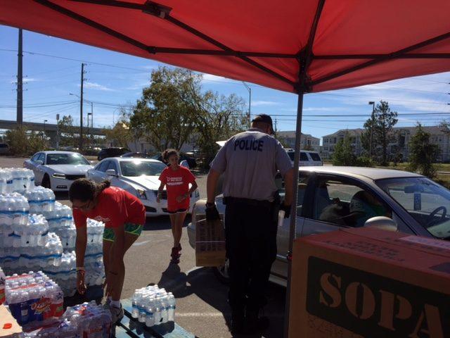 Hurricane volunteers handing out water